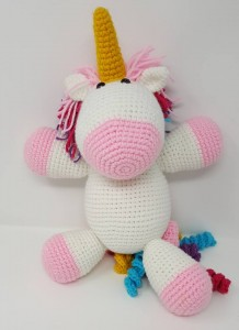 Rainbow Cuddles Stuffed Crochet Unicorn with Bow on Tail Project (huggable view) a chick crafting through Rheumatoid Arthritis cRAfterChick.com