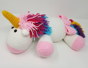 Rainbow Cuddles Stuffed Crochet Unicorn with Bow on Tail Project (side view) a chick crafting through Rheumatoid Arthritis cRAfterChick.com