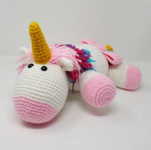 Rainbow Cuddles Stuffed Crochet Unicorn with Bow on Tail Project (front view) a chick crafting through Rheumatoid Arthritis cRAfterChick.com